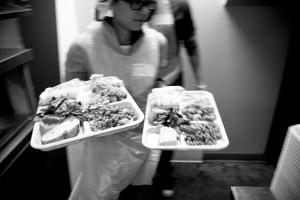 Jacqueline handles two full trays like a pro and serves to the hungry dining guests waiting at their tables