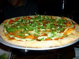 Bacon, Jalapeno, Arugula & Green Goddess Dressing Pizza. Bacon's the shining star of this pizza.